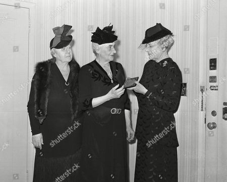 """Stock Photo of Anne Morgan, Florence Jaffray Harriman, Clara Whittaker Morrissey Anne Morgan, center, receives the American Women's Association award for eminent achievement in 1943 at the annual Friendship Meeting of the Association at the Hotel Pennsylvania in New York City, . Miss Morgan was honored for """"her interest and work for professional and businesswomen."""" Presentation is made by Florence Harriman, wife of New York financier J. Borden Harriman, right, and Clara Whittaker Morrissey, president of the Women's Press Club of New York"""