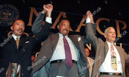 Stock Picture of JACKSON BOND MFUME Rev. Jesse Jackson is flanked by NAACP Chairman Julian Bond, right, and NAACP President Kweisi Mfume at the 90th annual NAACP convention in New York