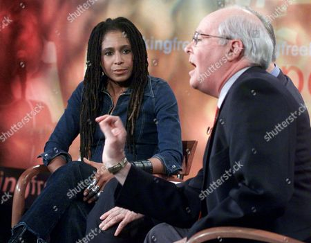 "Stock Image of COX DONOHUE Photographer Renee Cox, the artist of ""Yo Mama's Last Supper,"" listens to William Donohue, president of the Catholic League for Religious and Civil Rights, during their appearance on ""Speaking Freely"", in New York, . Donohue called Cox's nude image of herself as Christ at the Last Supper an example of Catholic bashing and said the solution is to eliminate public funding for the arts"