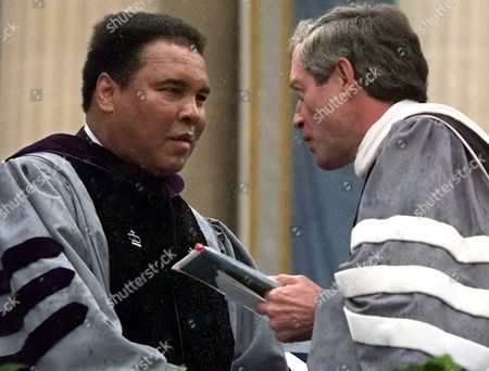 Stock Picture of ALI RUPP Columbia University President George Rupp, right, congratulates boxing legend Muhammad Ali after presenting Ali with an honorary Doctor of Laws degree at New York's Columbia University