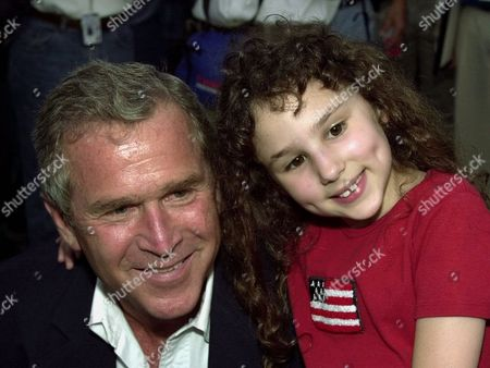 BUSH EISENBERG Republican presidential candidate Texas Gov. George W. Bush, poses with Pepsi Cola spokesmodel Hallie Eisenberg before the start of the Pepsi 400 NASCAR race Saturday night, at the Daytona International Speedway in Daytona Beach, Fla. Bush served as grand marshall for the race