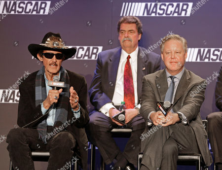 Brian France, Richard Petty, Mike Helton Team owner Richard Petty, left, speaks as NASCAR Chairman and CEO Brian France, right, and NASCAR president Mike Helton, back, listens during a news conference in Charlotte, N.C., . NASCAR announced a new charter system for team owners