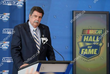 Mike Helton NASCAR president Mike Helton speaks during the 2017 class of the NASCAR Hall of Fame announcement in Charlotte, N.C