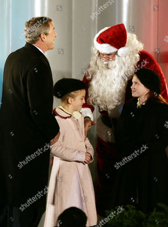 BUSH PITTS MASTRACCHIO President Bush greets Santa Claus, played by Willard Scott, with children Clara Pitts, second left, and Nicole Mastracchio at the conclusion of the National Christmas Tree lighting ceremony in The Ellipse in front of the White House in Washington