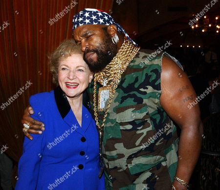 """WHITE MR. T Betty White, from """"Golden Girls,"""" and Mr. T, Lawrence Tureaud, from """"The A Team,"""" pose for photographers at NBC's 75th Anniversary Party, in the Hollywood section of Los Angeles"""