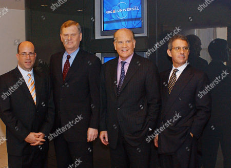 Executives of NBC Universal pose for a photo after completing the deal to merge NBC with the Universal entertainment businesses in New York. The executives are, from left, Jeff Zucker, president of the NBC Universal Television Group; Randy Falco, president of the NBC Universal Television Networks Group; Bob Wright, chairman and chief executive officer of NBC Universal; and Ron Meyer, president and chief operating officer of Universal Studios