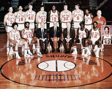 New York Knicks team portrait from the 1972-1973 season. From left to right: Bottom row: Henry Bibby, Walt Frazier, Ned Irish (president), Irving Mitchell Felt (Chairman of the Board), William (Red) Holzman (Gen.Mgr & Coach), Earl Monroe, Dick Barnett, Harthorne Wingo (Insert); Top row: Bill Bradley, Phil Jackson, John Gianelli, Dave De Busschere, Willis Reed, Jerry Lucas, Tom Riker,Dean Meminger, Trainer Danny Whalen, 1973