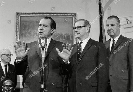 President Richard Nixon announces the promotion of Dr. Thomas O. Paine, center, from deputy administrator of the National Aeronautics and Space Administration to new head of the space agency, at the White House in Washington. Paine has been serving as acting administrator of NASA since the retirement of James E. Webb last fall. At right is Vice President Spiro Agnew