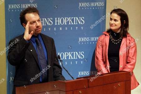 Adam Riess, Nancy Riess Dr. Adam Riess, left, speaks alongside his wife Nancy at a news conference to acknowledge his Nobel Prize in Physics at Johns Hopkins University in Baltimore, . Riess shared the prize with Saul Perlmutter, an astrophysicist at the University of California, Berkeley, and Brian Schmidt of the Australian National University, for their contributions to the discovery that the universe's expansion is accelerating