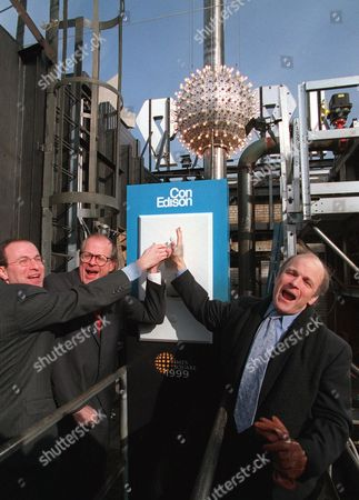 STRAUS NUTANT SEXTON New Year's Eve Countdown Entertainment President Jeffrey Straus, left, Con Edison Vice President John Nutant, center, and Times Square Business Improvement District President Brendan Sexton flip the switch to test run the lighting and lowering of New York's New Year's Eve ball during a rooftop dress rehearsal