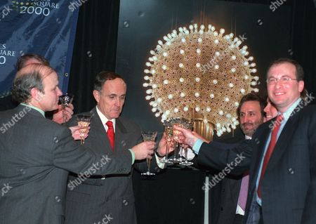 STRAUS Times Square Business Improvement District President Brendan Sexton, left, New York City Mayor Rudolph Giuliani, second from left, actor and Chairman of New York City 2000 Ron Silver, right rear, and President of Countdown Entertainment Jeffrey A. Straus, right, make a toast at a press conference in New York . The Times Square New Year's Eve ball, right, will usher in a brand New Year for the last time on Dec. 31, and will be replaced by the time of the millinneal celebration with a brand new ball made of crystal by Waterford Crystal