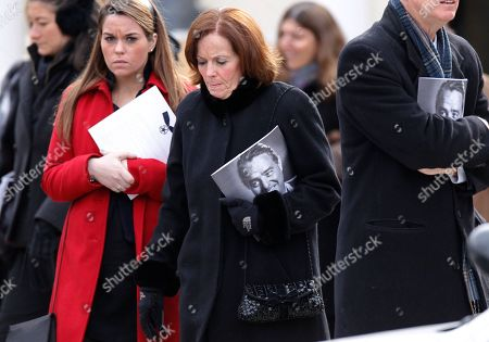 Mourners leave following the funeral Mass for R. Sargent Shriver at Our Lady of Mercy Catholic church in Potomac, Md., just outside Washington, . Shriver, the man responsible for launching the Peace Corps after marrying into the Kennedy family, died last Tuesday at age 95 after suffering from Alzheimer's disease for years