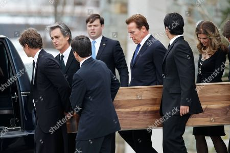Maria Shriver, Arnold Schwarzenegger The casket of R. Sargent Shriver is carried from Our Lady of Mercy Catholic Church after a funeral Mass in Potomac, Md., just outside Washington, . His daughter, Maria Shriver, is at right, joined by her husband, actor and former California Governor Arnold Schwarzenegger, third from right. Shriver, the man responsible for launching the Peace Corps after marrying into the Kennedy family, died last Tuesday at age 95 after suffering from Alzheimer's disease for years