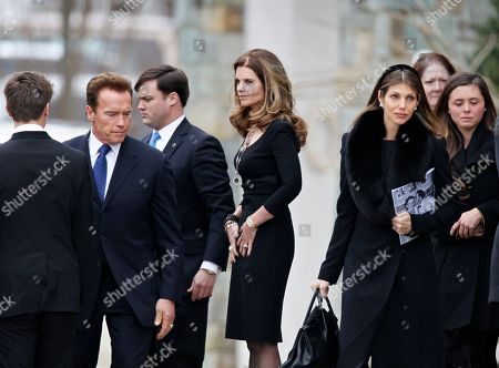 Maria Shriver, Arnold Schwarzenegger Maria Shriver, center, pauses as mourners leave following the funeral Mass for her father, R. Sargent Shriver, at Our Lady of Mercy Catholic Church in Potomac, Md., just outside Washington, . Shriver, the man responsible for launching the Peace Corps after marrying into the Kennedy family, died last Tuesday at age 95 after suffering from Alzheimer's disease for years. She is joined by her husband, actor and former California Governor Arnold Schwarzenegger, second from left