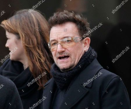 Bono Rock singer Bono leaves following the funeral Mass for R. Sargent Shriver at Our Lady of Mercy Catholic church in Potomac, Md., just outside Washington, . Shriver, the man responsible for launching the Peace Corps after marrying into the Kennedy family, died last Tuesday at age 95 after suffering from Alzheimer's disease for years
