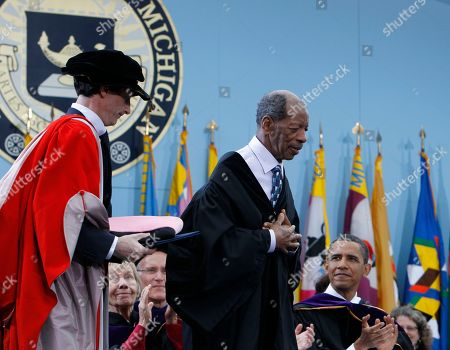 Stock Picture of Barack Obama, Ornette Coleman Jazz musician Ornette Coleman, center, stands to receive an honorary Doctor of Music degree as President Barack Obama looks on at the University of Michigan commencement ceremony in Ann Arbor
