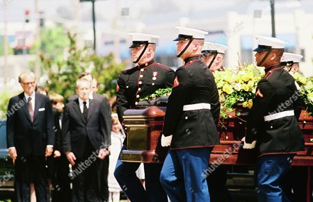 A Marine Corps color guard carries the casket of Patricia Ryan Nixon past former President Richard Nixon, second from left, and the Rev. Billy Graham upon arrival at the Richard Nixon Library and Birthplace in Yorba Linda, California. Mrs. Nixon died Tuesday, and burial will be Saturday on the library grounds