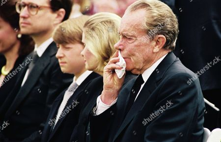 Former President Richard Nixon wipes his face as funeral services begin for his wife, former first Pat Nixon on Saturday, June, 26, 1993 in Yorba Linda, California. Others from left, son-in-law Ed Cox, grandson Christopher Cox, and daughter Tricia Nixon Cox