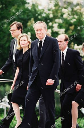 Stock Photo of Former President Richard Nixon, center, with his family members arrives on at the the Richard Nixon Library and Birthplace in Yorba Linda, California for funeral services for his wife, Patricia Ryan Nixon. Mrs. Nixon died Tuesday. Other family member visible are daughter Tricia Nixon Cox and her husband, Ed Cox, at left, and son-in-law David Eisenhower, right