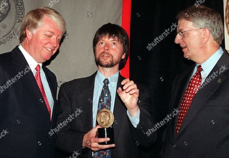 ADAMS BURNS BARNES Documentary producer Ken Burns, center, speaks with University of Georgia President Michael Adams, left, and Governor of Georgia Roy Barnes at the 58th annual Peabody Awards ceremony for broadcast and cable excellence, in New York. Burns and editor Lynn Novick won a Peabody Award for their film on the life and work of Frank Lloyd Wright