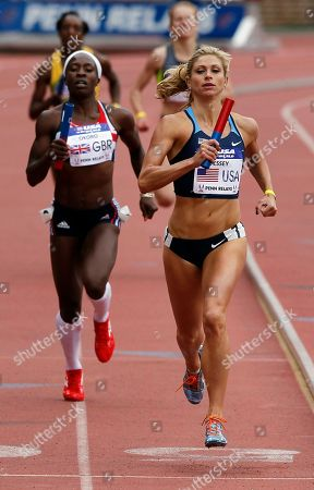 Marilyn Okoro, Maggie Vessey Maggie Vessey, right, of the USA Blue team crosses the finish line ahead of Great Britain's Marilyn Okoro in the USA vs. the world women sprint medley at the Penn Relays athletics meet in Philadelphia. USA Blue team won with a time of 3:42.85