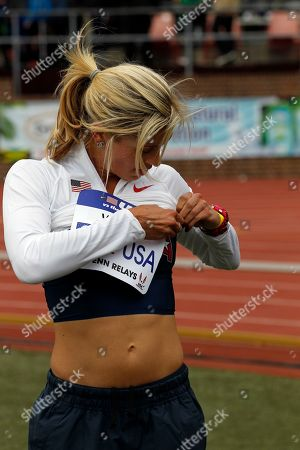 Maggie Vessey Maggie Vessey, of Team USA, pins her number on during the Penn Relays athletics meet in Philadelphia