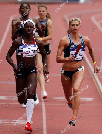 Marilyn Okoro, Maggie Vessey Maggie Vessey, right, of the USA Blue team takes the baton after the exchange, next to Great Britain's Marilyn Okoro, left, in the USA vs. the world women sprint medley at the Penn Relays athletics meet in Philadelphia. USA Blue team won with a time of 3:42.85