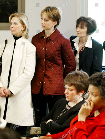 HUGHES WAGNER Olympic figure skating gold medalist Sarah Hughes, center, with her mother Amy Hughes, right, and coach Robin Wagner, left, watch the daily briefing by White House Press Secretary Ari Fleischer, Friday, April, 12, 2002, at the White House. Hughes met earlier with President Bush