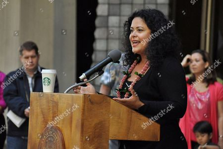 """Maya Soetoro-Ng, sister of President Barack Obama, speaks at a rally supporting state-funded preschool at the Hawaii State Capitol in Honolulu on . As the doors closed on the first meeting of state budget negotiations at the Hawaii State Capitol, attendees could hear advocates for state-funded preschool chanting, """"Keiki first!"""" from three floors below. Lawmakers met Thursday to debate the budget in conference committee and were greeted by early childhood education advocates rallying for funds"""