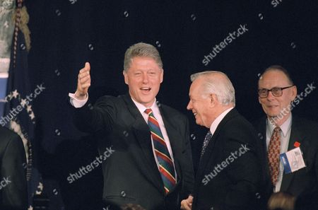 Bill Clinton, Hugh Downs President Bill Clinton gestures prior to addressing the White House Conference on Aging in Washington . Television personality Hugh Downs, a participant in the conference is at right