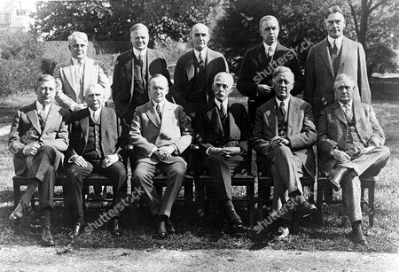 American President Calvin Coolidge with his Cabinet on the lawn of the White House, Washington, D.C., . From left to right front row; Dwight Davis, Secretary of War; Frank B. Kellogg, Secretary of State; President Coolidge; Andrew W. Mellon, Secretary of Treasury; John G. Sargent, Attorney-General; Harry New, Postmaster General. Back row from left to right; James J. Davis, Secretary of Labor; Herbert Hoover, Secretary of Commerce; William M. Jardine, Secretary of Agriculture; Hubert Work, Secretary of Interior and Curtis D. Wilbur, Secretary of Navy