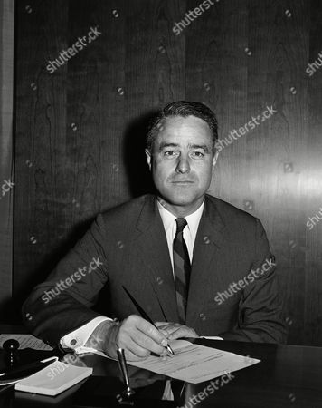 Robert Sargent Shriver, Jr Sargent Shriver, brother-in-law of President Kennedy, poses in his office on in Washington after he was sworn in as director of the Peace Corps