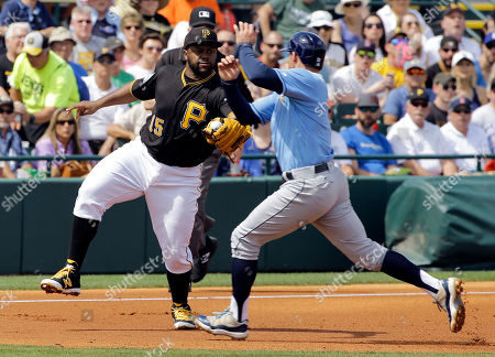 Pittsburgh Pirates third baseman Jason Rogers (15) forces Tampa Bay Rays' Brad Miller at third base on a double play during the second inning of a spring training baseball game, in Bradenton, Fla