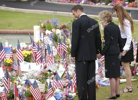 DAVIS REAGAN Nancy Reagan, center, is joined by her children Ronald Prescott Reagan, left, and Patti Davis as they look over hundreds of flags, flowers and messages in honor of former President Ronald Reagan at a funeral home in Santa Monica, Calif., where Reagan's body lies . They were to escort Reagan's casket to the Reagan Library