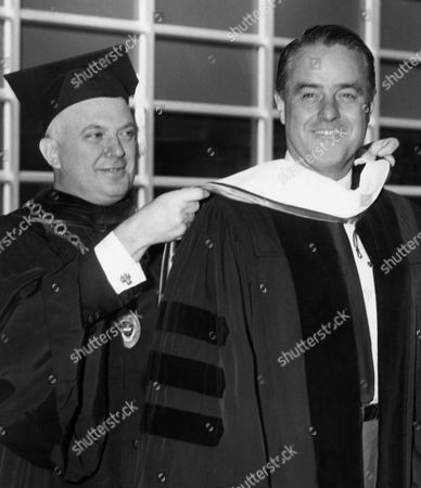 Sargent Shriver, Edward Sponga The Very Rev. Edward J. Sponga, S.J., President of U. S. of Scranton, drapes academic colors mantle over shoulders of R. Sargent Shriver, Peace Corps director, during presentation of honorary doctorate of humane letters to the brother in law of the late President John F. Kennedy on September 18. Mr. Shriver spoke at university's annual convocation. Year not provided