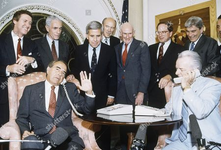 Senate Minority Leader Robert Dole of Kansas, left, and Senate Majority Leader Robert Byrd of West Virginia call President Ronald Reagan in Helsinki from Capitol Hill in Washington, to inform him of the ratification of the INF Treaty. Behind them are, from left, Sens. William Cohen, R-Maine; Claiborne Pell, D-R.I.; Richard Lugar, R-IND.; Alan Simpson, R-Wyo.; Alan Cranston, D-Calif.; Sam Nunn, D-Ga.; John Warner, R-Va