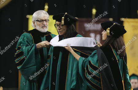"""Sixto Rodriguez Wayne State University Board of Governors Paul Massaron, left, and Sandra Hughes O'Brien confer a Doctor of Humane Letters honorary degree to Sixto Rodriguez, in Detroit, during the university's commencement. Rodriguez's two albums in the early 1970s received little attention in the United States but he unknowingly developed a cult following in South Africa during the apartheid era. He was the subject of an Oscar-winning documentary, """"Searching for Sugar Man"""