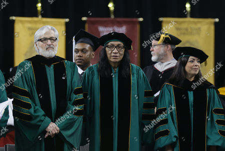 """Sixto Rodriguez Musician Sixto Rodriguez, center, stands with Wayne State University Board of Governors Paul Massaron, left, and Sandra Hughes O'Brien, right, during the university's commencement ceremony in Detroit, . Rodriguez received a Doctor of Humane Letters honorary degree. Rodriguez's two albums in the early 1970s received little attention in the United States but he unknowingly developed a cult following in South Africa during the apartheid era. He was the subject of an Oscar-winning documentary, """"Searching for Sugar Man"""