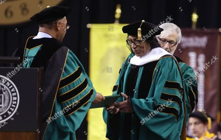 """Sixto Rodriguez Wayne State University Board of Governors Vice Chair Gary Pollard, left, presents a Doctor of Humane Letters honorary degree to Sixto Rodriguez, in Detroit, during the university's commencement. Rodriguez's two albums in the early 1970s received little attention in the United States but he unknowingly developed a cult following in South Africa during the apartheid era. He was the subject of an Oscar-winning documentary, """"Searching for Sugar Man"""