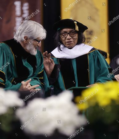 """Sixto Rodriguez Wayne State University Board of Governors Paul Massaron, left, talks with Sixto Rodriguez after Rodriguez received a Doctor of Humane Letters honorary degree, in Detroit, during the university's commencement ceremony. Rodriguez's two albums in the early 1970s received little attention in the United States but he unknowingly developed a cult following in South Africa during the apartheid era. He was the subject of an Oscar-winning documentary, """"Searching for Sugar Man"""