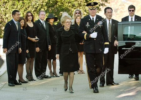 Stock Photo of DAVIS Nancy Reagan is escorted into the Ronald Reagan Presidential Library for the memorial service and burial of former President Reagan in Simi Valley, Calif., . Family members from left rear are Ronald Prescott Reagan and his wife Doria, Patti Davis, Michael Reagan and his wife Colleen, their son Cameron (obscured) and daughter Ashley, and Diana Wilson, fiancee of Dennis Revell (unseen