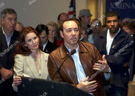 GILBERT SPACEY LASALLE Screen Actors Guild President Melissa Gilbert, left, and actors Kevin Spacey, at podium, Eriq La Salle, right, join prominent guild members in addressing questions from reporters, at SAG headquarters in Los Angeles. SAG officially launched Wednesday the enforcement globally of Rule One, which requires members working domestically to sign only union contracts
