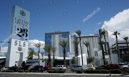 Vehicles drive past the SLS Las Vegas casino in Las Vegas. One of the newest names on the Las Vegas Strip is laying off staff and cutting restaurant hours less than two months after opening. Sam Nazarian has been the face of the property since he purchased it when it was still the Sahara in 2007. He closed the Sahara four years later, then reopened it as SLS Las Vegas following a $415 million overhaul