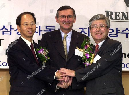 JOINT VENTURE George Douin, vice president of French car-maker Renault, center, shakes hands with Je Jin-hoon, president of Samsung Capital Co., Ltd of South Korea, left, and Lee Yong-soon, vice president of the Samsung Card Co., Ltd of South Korea, after signing the joint venture agreement on Samsung Motors Inc., in Pusan, 400 kilometers (250 miles) southeast of Seoul, . Renault will get a 70.1 percent stake in Samsung Motors Inc