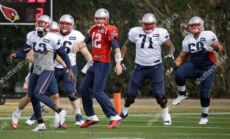 Brandon LaFell, Bryan Stork, Tom Brady, Cameron Fleming, Caylin Hauptmann New England Patriots players, including wide receiver Brandon LaFell (19), center Bryan Stork (66), quarterback Tom Brady (12), guard Cameron Fleming (71), and practice squad offensive lineman Caylin Hauptmann (68), warm up during practice, in Tempe, Ariz. The team is practicing at the Arizona Cardinals' facility. The Patriots play the Seattle Seahawks in NFL football Super Bowl XLIX Sunday, Feb. 1, in Glendale, Ariz