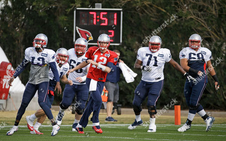 Stock Image of Brandon LaFell, Bryan Stork, Tom Brady, Cameron Fleming, Caylin Hauptmann New England Patriots players, including wide receiver Brandon LaFell (19), center Bryan Stork (66), quarterback Tom Brady (12), guard Cameron Fleming (71), and practice squad offensive lineman Caylin Hauptmann (68), warm up during practice, in Tempe, Ariz. The team is practicing at the Arizona Cardinals' facility. The Patriots play the Seattle Seahawks in NFL football Super Bowl XLIX Sunday, Feb. 1, in Glendale, Ariz