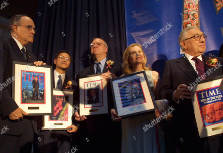 KISSINGER Former New York City Mayor Rudolph Giuliani, Dr. David Ho, James Roosevelt, grandson of Franklin D. Roosevelt, Patricia Nixon Cox, daughter of Richard Nixon, and former National Security Advisor Dr. Henry Kissinger, from left, hold previous Time covers during an exhibition, hosted by the magazine, commemorating the 75th anniversary of the Person of the Year, in New York