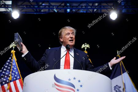 "Donald Trump Republican presidential candidate, businessman Donald Trump holds a Bible as he speaks during the Iowa Faith & Freedom Coalition's annual fall dinner in Des Moines, Iowa. Producers at CBS are making four separate episodes of ""60 Minutes"" for Sunday, trying to fit in three stories, including an interview with Trump. Scott Pelley will press Trump for specifics on issues like taxes, education, defense and immigration"