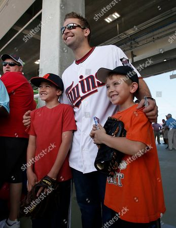 Brian Dozier Minnesota Twins' Brian Dozier poses with young fans for a photo as Dozier and other players greet attendees to Hammond Stadium during a Twins open house event at baseball spring training in Fort Myers Fla