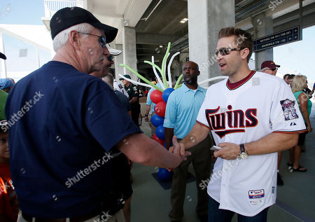 Brian Dozier Minnesota Twins' Brian Dozier, right, greets fans at the front gates of Hammond Stadium during a Twins open house event at baseball spring training in Fort Myers Fla